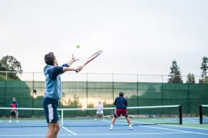 Group of friends playing tennis